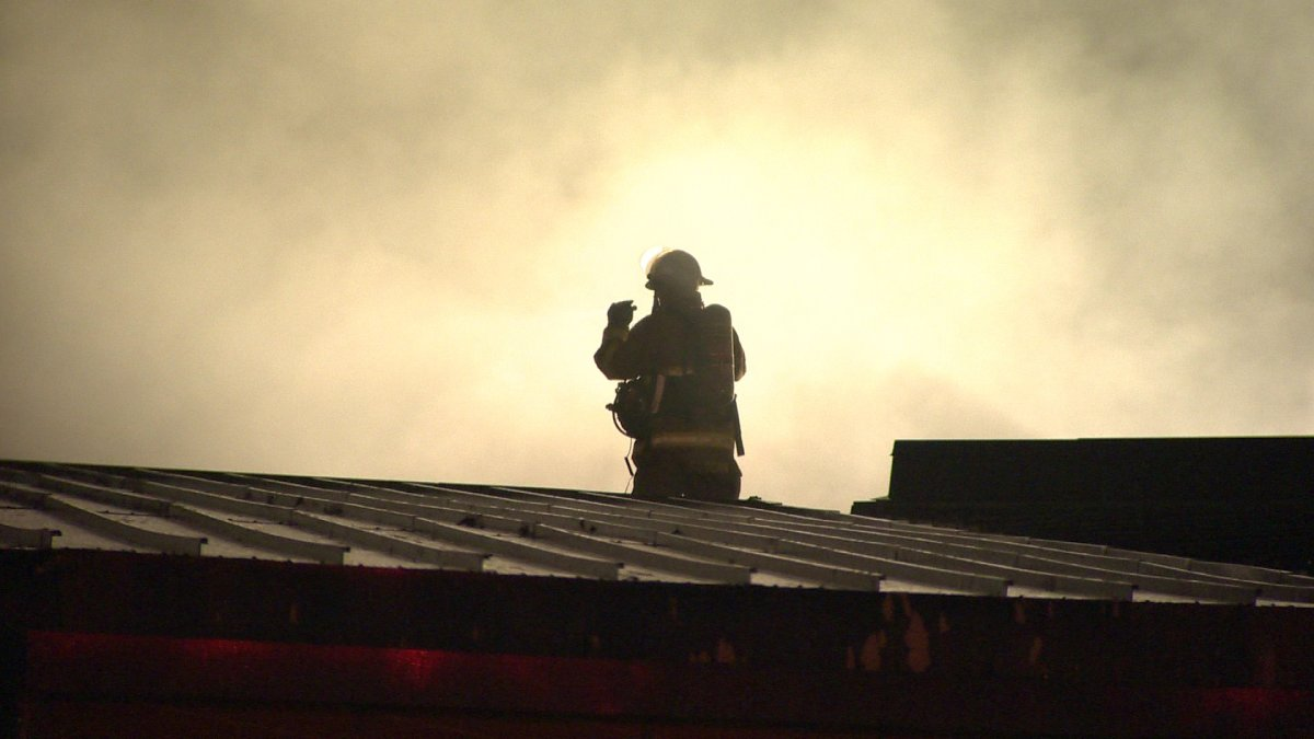 A Halifax firefighter investigates smoke on the roof of the Dartmouth Sportsplex on  Monday, September 30, 2013.