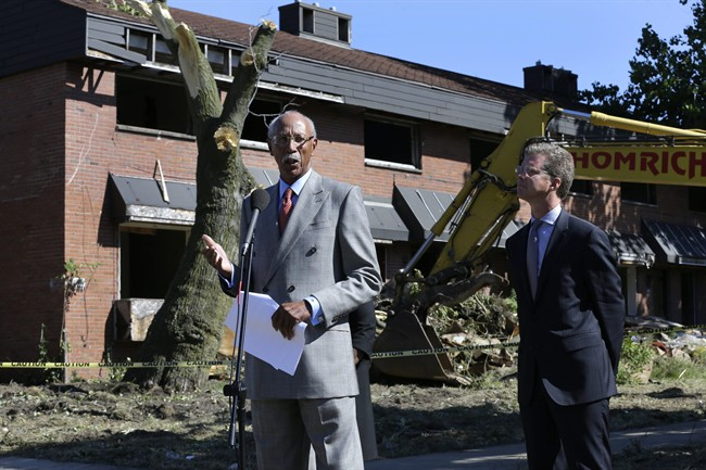 Detroit Mayor Dave Bing, left, speaks while United States Department of Housing and Urban Development Secretary Shaun Donovan listens at the first stage of demolishing the Frederick Douglass Homes in Detroit, Wednesday, Sept. 4, 2013. The graffiti-covered complex comprising several city blocks is better known as the Brewster projects. A $6.5 million emergency federal grant covers the initial phase of demolition and cleanup, and officials say the city will be eligible for more money when that's completed. The federal money comes at a crucial time for the city, which is overseen by a state-appointed emergency manager and in July became the nation's largest city to file for bankruptcy.