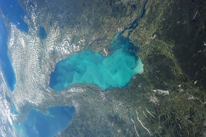 This photograph, taken from the International Space Station, shows a massive plankton bloom in Lake Ontario.