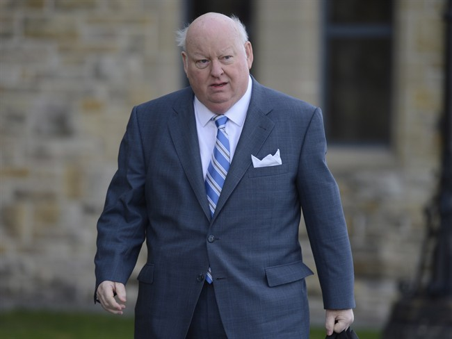 Sen. Mike Duffy arrives to the Senate on Parliament Hill in Ottawa, Monday, October 28, 2013.