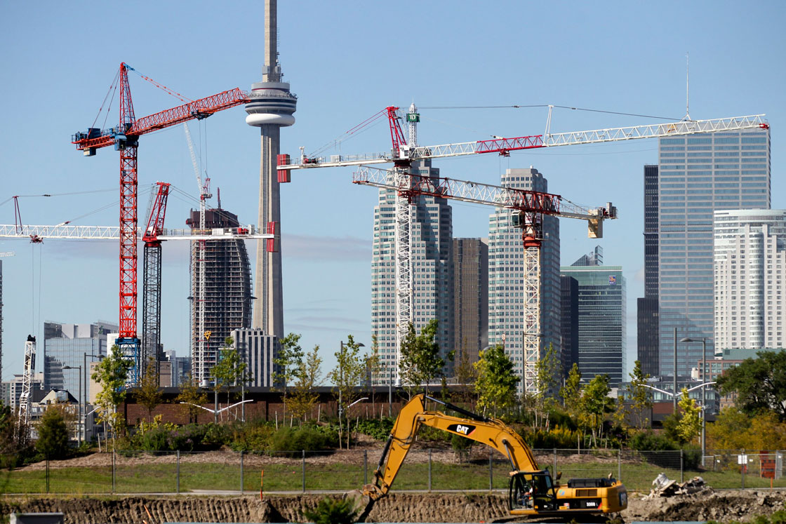 Cranes erecting condos dot Toronto's skyline.