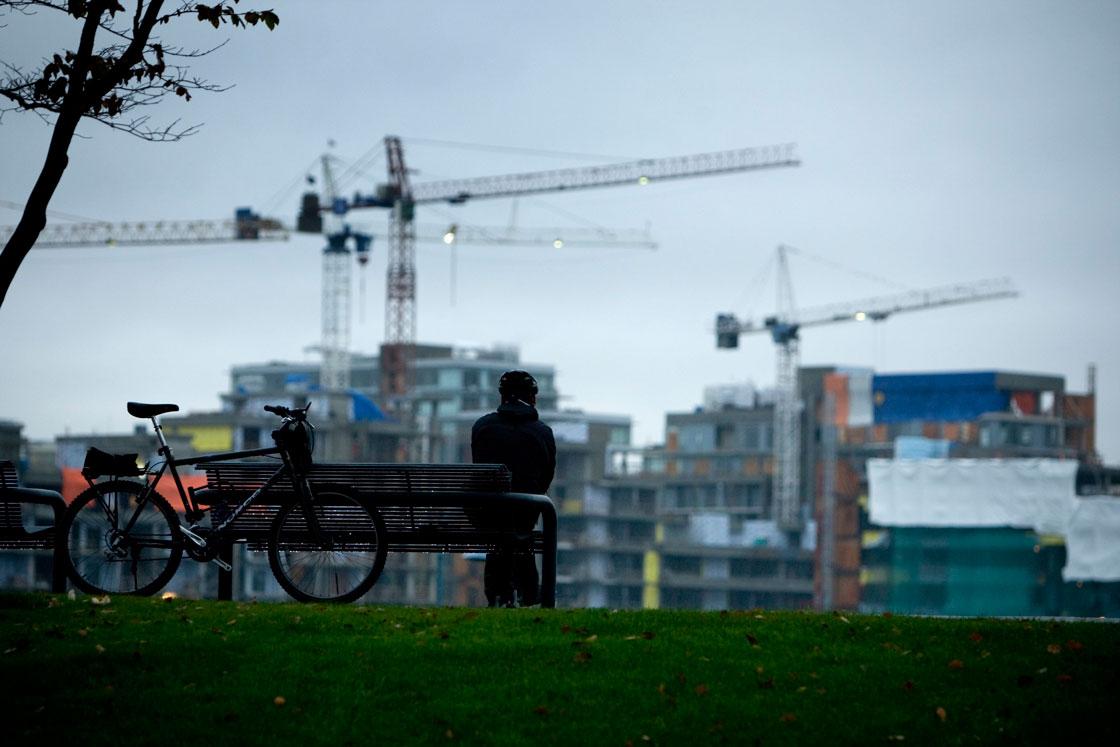 Cranes sit atop condo developments along Toronto's waterfront.