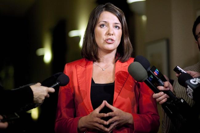 Wildrose Party Leader Danielle Smith speaks to reporters in Calgary, Alta., Thursday, Jan. 24, 2013.
