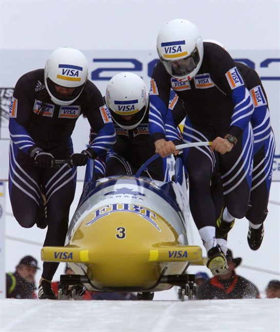 FILE: Canadians Pierre Lueders (right), Ben Hindle (left), Ken LeBlanc (centre) and Mark LeBlanc (back right) push their sleigh at the start of the 4-Man World Cup Bobsled heats in Calgary, Sunday February 18, 2001.