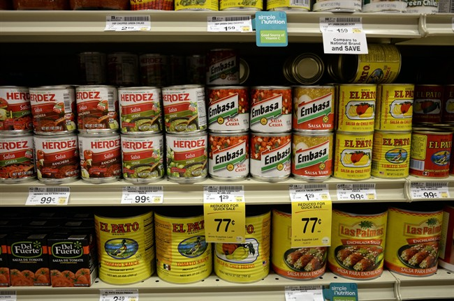 Salsas and other items are seen in the International food aisle of a grocery store.