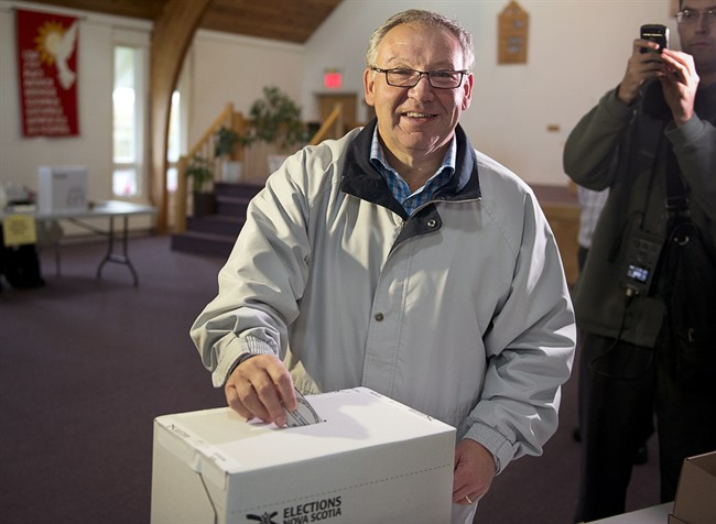 Darrell Dexter votes in the Nova Scotia provincial election in Cole Harbour, N.S. on Oct. 8, 2013.