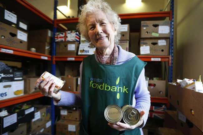Food bank volunteer Diana Grant sorts cans in this file photo.