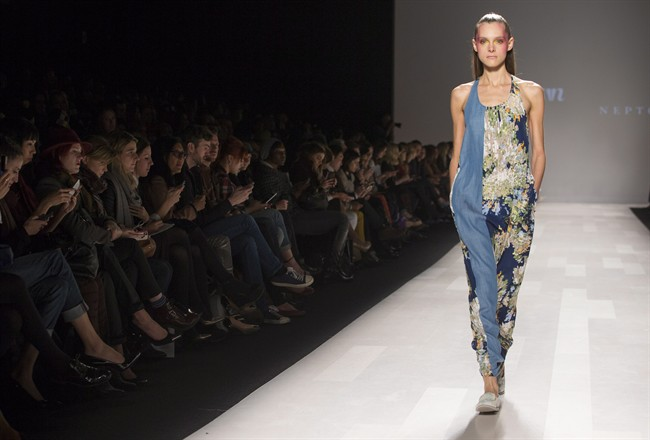 A model walks the runway in the Melissa Nepton show during Toronto Fashion Week in Toronto, Tuesday October 22, 2013.