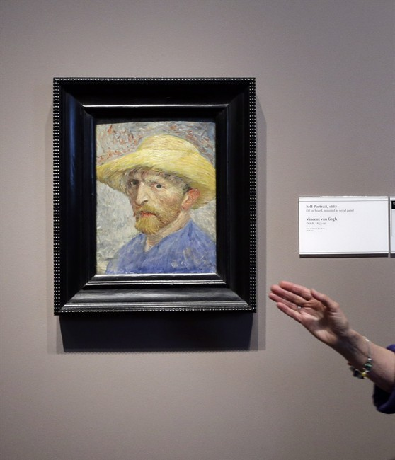 FILE- In a June 13, 2013, file photo, Detroit Institute of Arts docent Lea Schelke points out details in the Self-Portrait by Van Gogh displayed at the museum in Detroit.