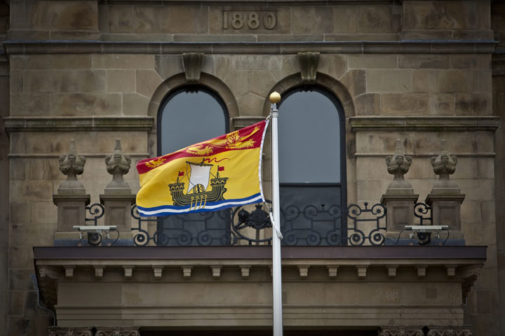 New Brunswick flag flies in front of the Legislative building in Fredericton, New Brunswick on April 4, 2012.