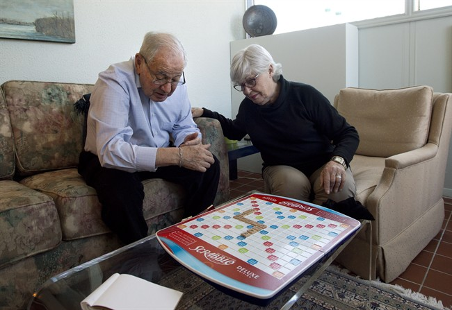Sandra Atlin plays Scrabble with her husband Gordon, who has Alzheimer's disease, at their home in Toronto on Friday, Oct. 11, 2013.