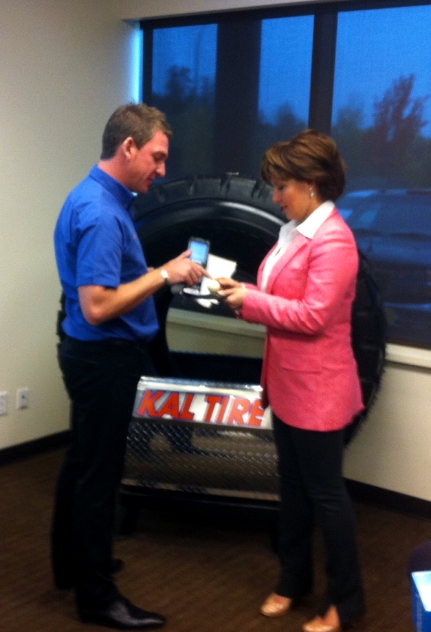 BC Premier Christy Clark is presented with information about tire monitoring technology by a Kal Tire representative in Vernon Friday.