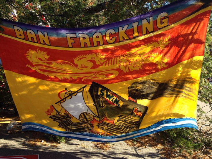 A New Brunswick flag with an anti-fracking message at a protest site near Rexton, N.B.