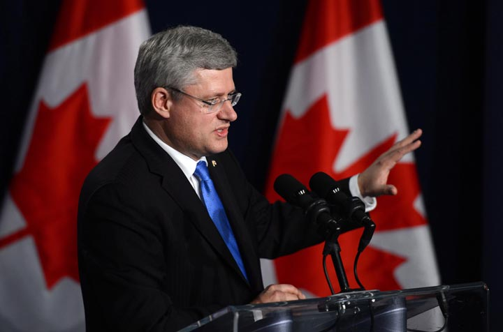 Prime Minister Stephen Harper takes part in a closing press conference in Nusa Dua, Bali, Indonesia on Tuesday, October 8, 2013.