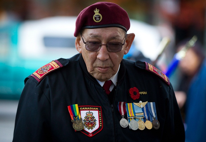 Korean War veteran Allen Derouin, 77, of the Ojibwe First Nation in Hudson, Ont., who served with the 2nd Battalion, Princess Patricia's Canadian Light Infantry, attends a National Aboriginal Veterans Day ceremony at the Victory Square Cenotaph in Vancouver, B.C., on Friday November 8, 2013.