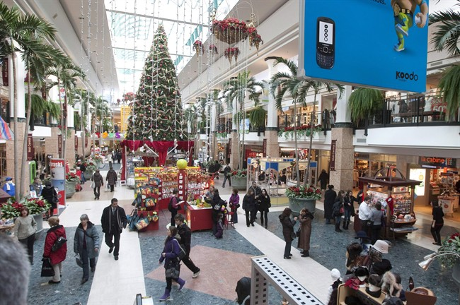 Christmas shoppers walk to stores at the Laurier shopping centre in Quebec City, Thursday, December 16, 2010.