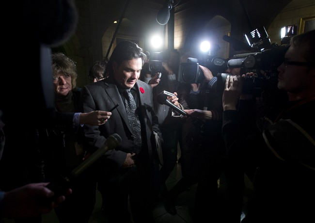 Sen. Patrick Brazeau makes his way to the Senate Thursday October 31, 2013 on Palriament Hill in Ottawa.