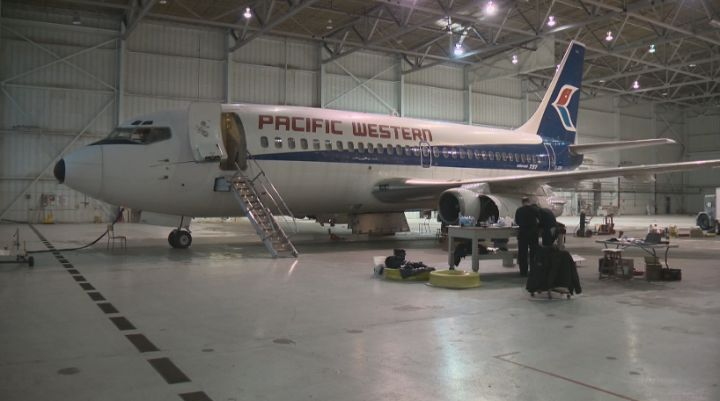 Crews work to inspect the Boeing 737 at the Alberta Aviation Museum Thursday, November 28, 2013.