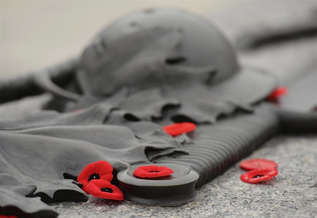Poppies lie on the Tomb of the Unknown Soldier at the National War memorial.