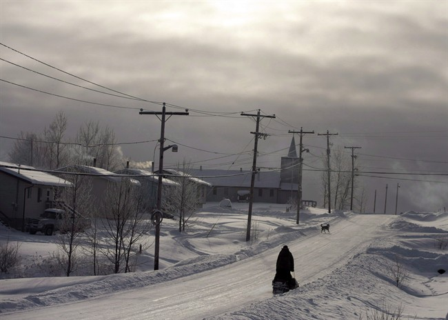 A snowmobile rides down the main street December 18, 2012, on the Fort Hope First Nation, part of Ontario's Ring of Fire.