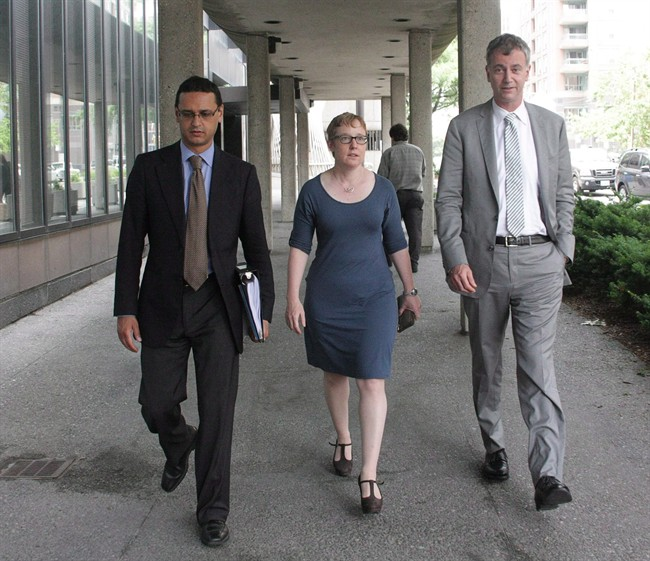 Julian Roy (left to right), lawyer for Ashley Smith's family, Breese Davies, lawyer for the Canadian Association of Elizabeth Fry Societies, and Richard Macklin, lawyer for Ontario's child advocate, are seen outside the Smith prison-death inquest in Toronto on Tuesday, June 25, 2013.