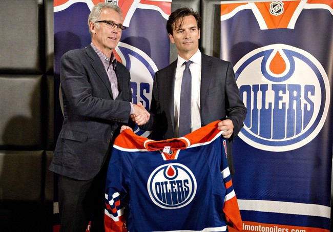 Edmonton Oilers general manager Craig MacTavish introduces the new head coach of the Edmonton Oilers, Dallas Eakins during a press conference in Edmonton, Alta., on Monday, June 10, 2013.