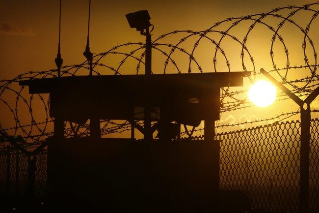In this photo reviewed by the U.S. military, the sun rises above Camp Delta at Guantanamo Bay Naval Base, Cuba, Wednesday, Nov. 20, 2013.