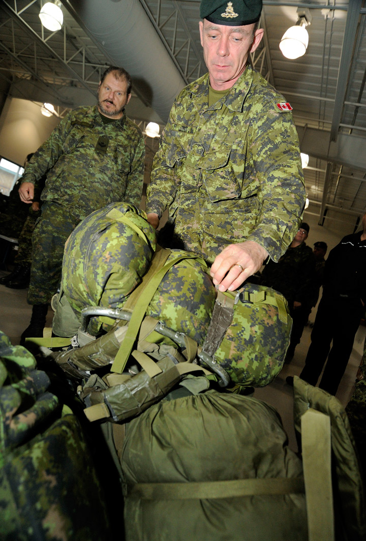 Master Warrant Officer David Milligan of a Disaster Assistance Response Team (DART) prepares his luggage for check-in at Canadian Forces Base Trenton on November 11, 2013.