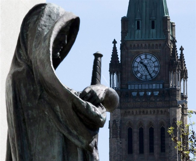 """""""Truth"""", left, the statue at the entrance of the Supreme Court of Canada in Ottawa, is shown on May 7, 2010."""