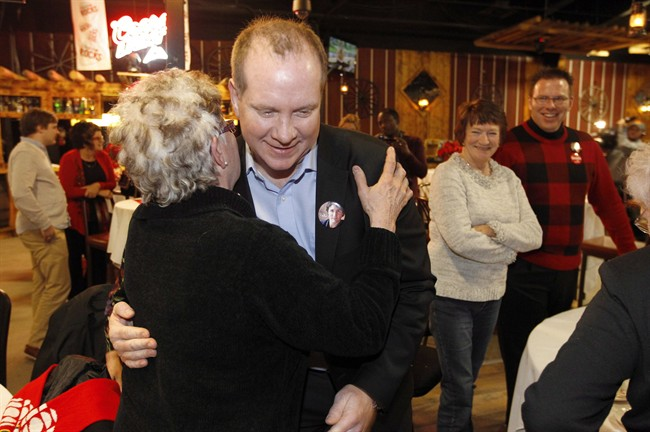 Liberal candidate Rolf Dinsdale greets supporters at his party during a tight byelection in the Brandon-Souris area in Brandon, Man., Monday, Nov. 25, 2013.
