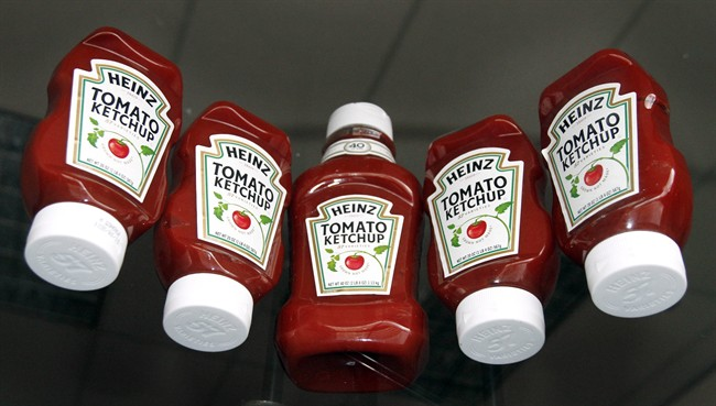 In this Sept. 1, 2010 photo, bottles of Heinz Ketchup are displayed in Portland, Ore.