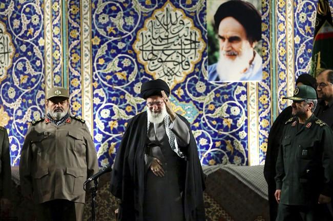 Iran's Supreme Leader Ayatollah Ali Khomenei waves to members of the paramilitary Basij force at the Imam Khomeini Grand Mosque in Tehran, Iran.
