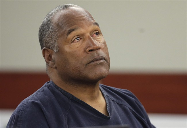 FILE - This May 13, 2013 file photo shows O.J. Simpson listening to testimony at an evidentiary hearing in Clark County District Court in Las Vegas.