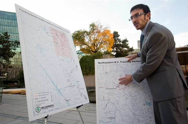 Eoin Madden, a climate campaigner with the Wilderness Committee, talks about sites indicated with dots on a map in northeastern B.C. where the provincial government has approved temporary water withdrawal for fracking. THE CANADIAN PRESS/Darryl Dyck.