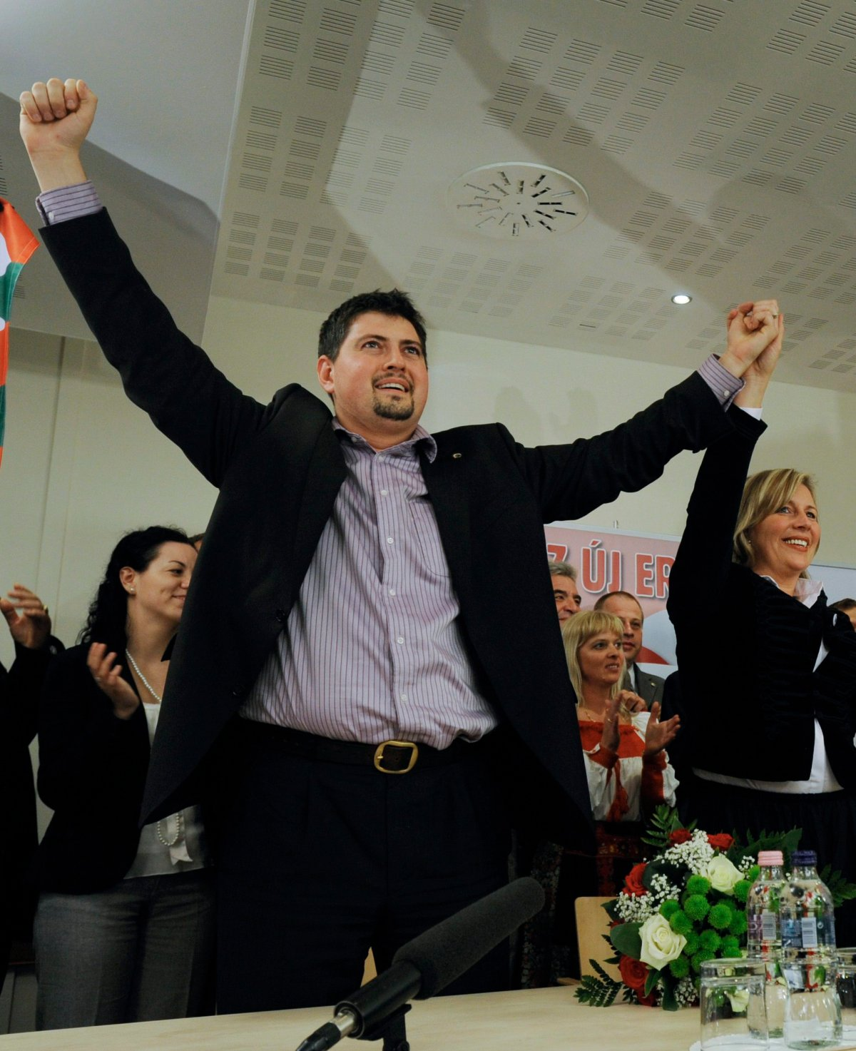 his file photo dated on June 7, 2009 shows Hungary's far right party, Jobbik's, Csanad Szegedi, left, and Krisztina Morvai, right, celebrating their entry into the European Parliament after the European parliamentary election in Budapest, Hungary. Szegedi, who was notorious for his incendiary comments on Jews, acknowledged in June that his grandparents on his mother's side were Jews. After resigning last month from all his party positions he was also asked by Jobbik to give up his seat in the European Parliament as well. (AP Photo/Bela Szandelszky, File).