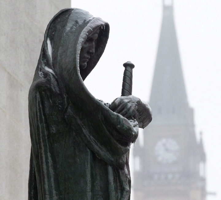 A statue representing Justice is seen in front of the Supreme Court building in Ottawa.
