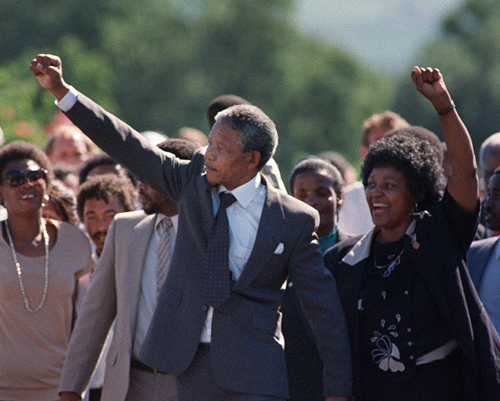 A picture taken on February 11, 1990 shows Nelson Mandela (C) and his then-wife Winnie raising their fists and saluting cheering crowd upon Mandela's release from the Victor Verster prison near Paarl.