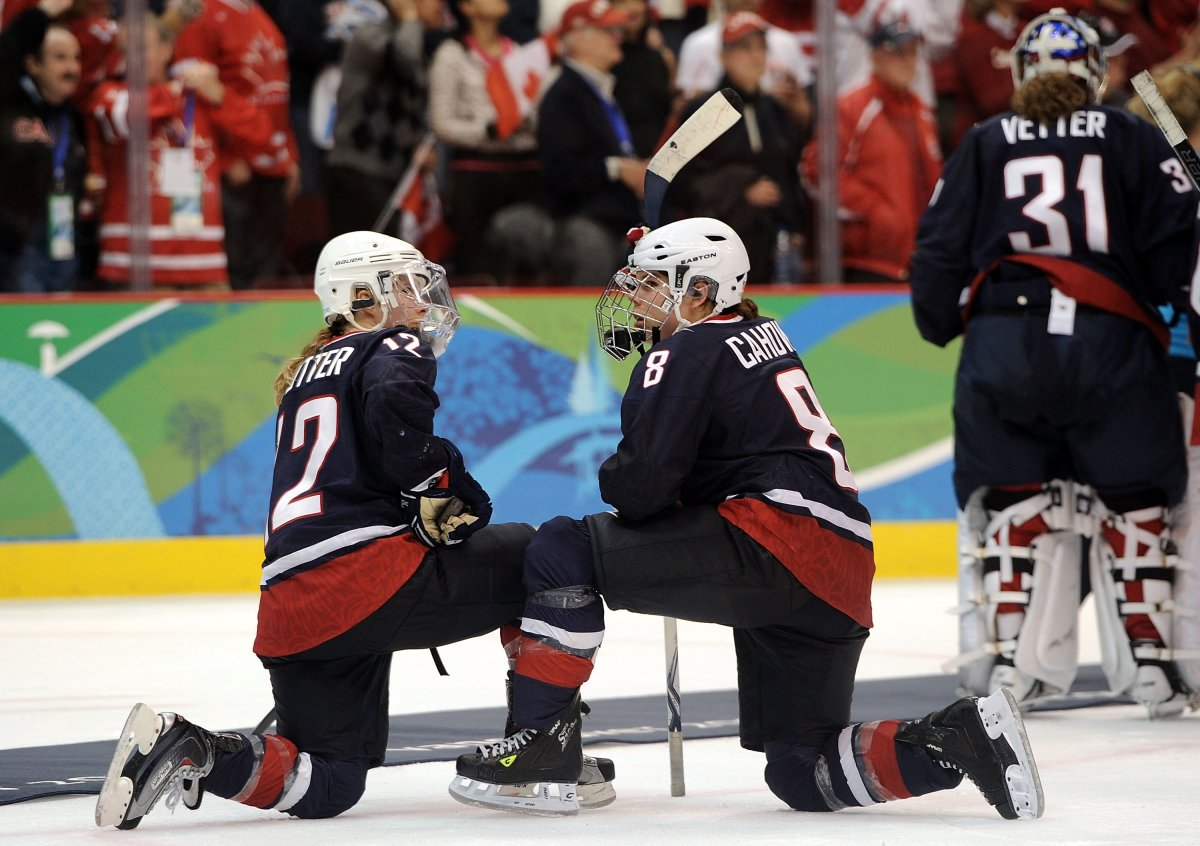 Jenny Potter #12 and Caitlin Cahow #8 of the United States kneel on the ice following their team's 2-0 defeat during the ice hockey women's gold medal game between Canada and USA on day 14 of the Vancouver 2010 Winter Olympics at Canada Hockey Place on February 25, 2010 in Vancouver, Canada.