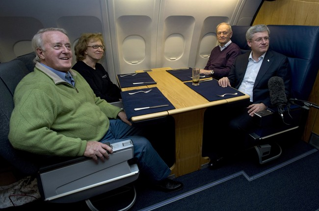 Former Canadian prime ministers Stephen Harper, Brian Mulroney , Kim Campbell and Jean Chretien on board a government plane headed for the memorial for South African icon Nelson Mandela in December 2013.