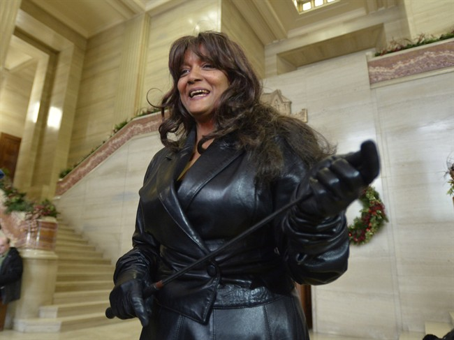 Terri-Jean Bedford talks to reporters at the Supreme Court of Canada in Ottawa Friday morning, Dec. 20, 2013 after learning Canada's highest court struck down the country's prostitution laws in their entirety in a unanimous 9-0 ruling.