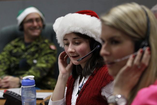 NORAD volunteers tracking Santa in 2013.