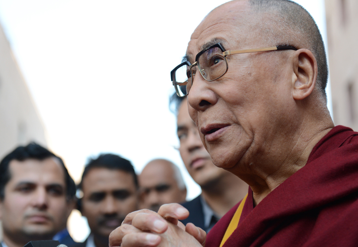 Tibetan spiritual leader The Dalai Lama speaks to members of the press about the passing of former South African president Nelson Mandela, as he attends a function in New Delhi on December 6, 2013.