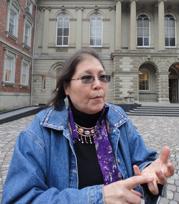 """Marcia Brown Martel speaks outside Osgoode Hall in Toronto, Wednesday, Dec.4, 2013. She is the representative plaintiff in a class action lawsuit that claims a devastating loss of cultural identity was suffered by Ontario victims of the so-called """"60s scoop.""""."""