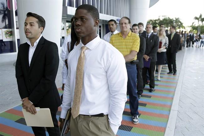 Students wait in line at an internship job fair.
