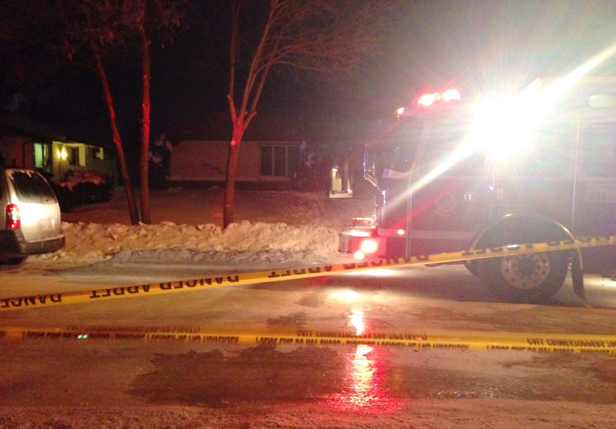 Fire crews on Tyndall Ave. in Winnipeg on Thursday December 19, 2013.
