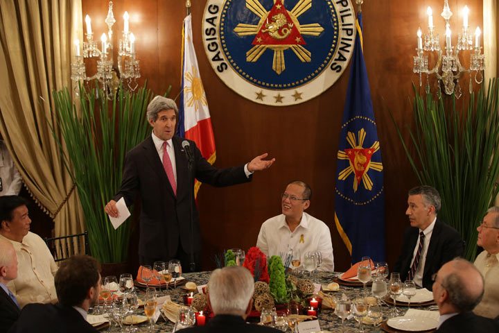 U.S. Secretary of State John Kerry, (2L) , gestures as he delivers a speech alongside Philippine President Benigno Aquino III, (C), ahead of a dinner at the Malacanang Presidential Palace in Manila on December 17, 2013.  (AARON FAVILA/AFP/Getty Images).