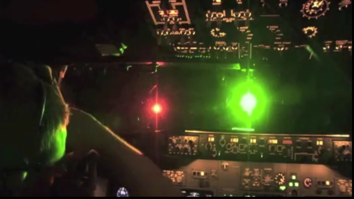 File photo of a laser being pointed at a plane.