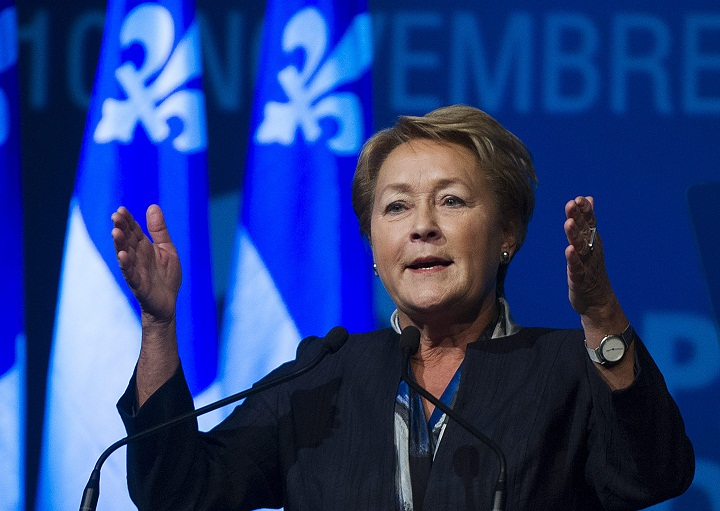 Quebec Premier Pauline Marois delivers a closing speech to delegates at a Parti Quebecois convention in Montreal, Sunday, November 10, 2013.
