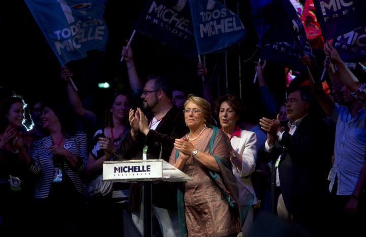 Chilean president-elect, Michelle Bachelet, applauds as she delivers a speech after getting the results of the run-off presidential election in Santiago on December 15, 2013. Socialist Michelle Bachelet was swept back into office Sunday as Chile's next president, on a platform of boosting education and narrowing the gap between rich and poor.