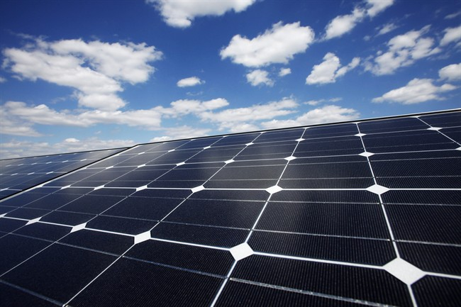 FILE - In this Friday, April 29, 2011, file photo, solar panels line the roof of Ikea's Brooklyn store, in New York.